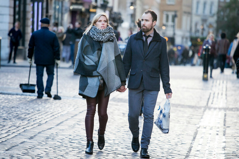 LONDON, UK - SEP 27: Young couple in love in London Street on November 27, 2016 in London, UK. London is the world's most visited city and the capital of UK.