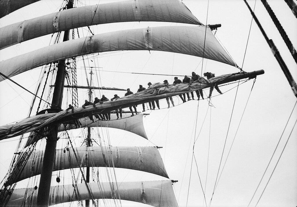 Furling sail on the main yard, 1932–33