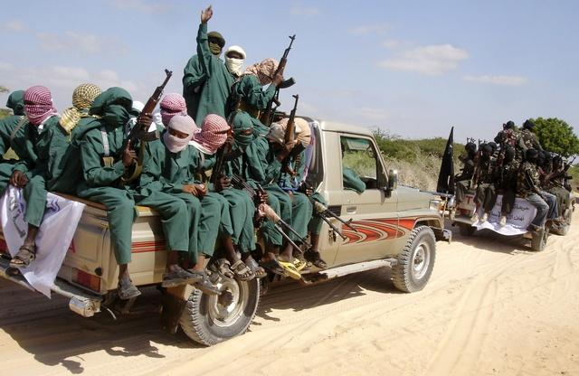 Militants of al Shabaab ride on pick-up trucks after displaying their weapons on the outskirts of Mogadishu