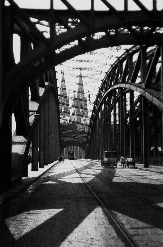 The bridge of cologne with the city's cathedral visible in the background, sometime between 1920-1930