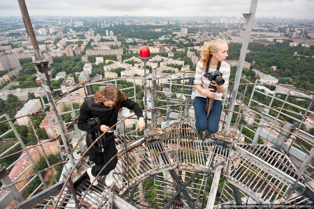 photographers on a radio tower