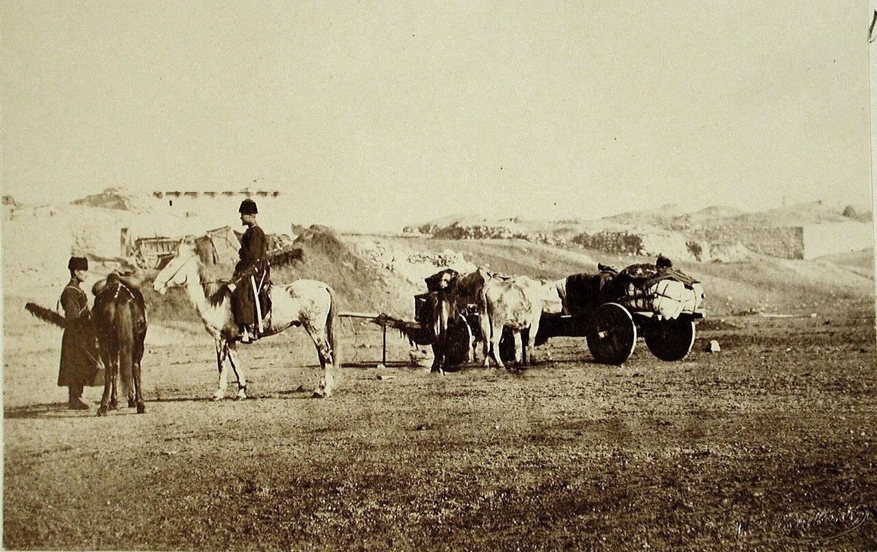 Всадники, остановившиеся у сакли в селении
