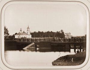 Вид на Петербургскую плотину;на втором плане-усадьба Званы с церковью.
