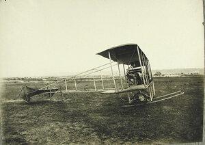 Авиатор и инженер И.И.Сикорский в кабине биплана своей конструкции; размах крыльев биплана - 8 м, длина - 7,5 м, вес - 200 кг,мотор «Анзани» -  25 лошадиных сил