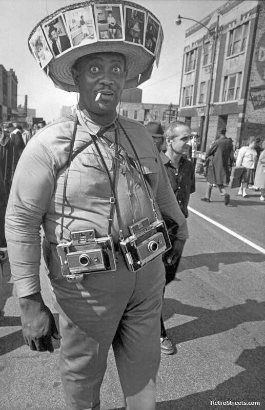 A photographer on Maxwell Street, 1970. Photograph by James Newberry..jpg