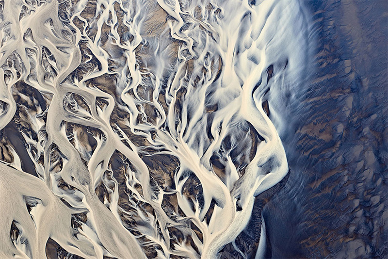 Aerial image of river delta in Iceland. © Emmanuel Coupe, 2014 Sony World Photography Awards.
