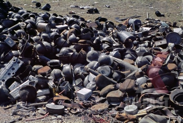 stock-photo-captured-french-army-helmets-and-military-personnel-equipment-near-french-coast-france-1940-12911.jpg