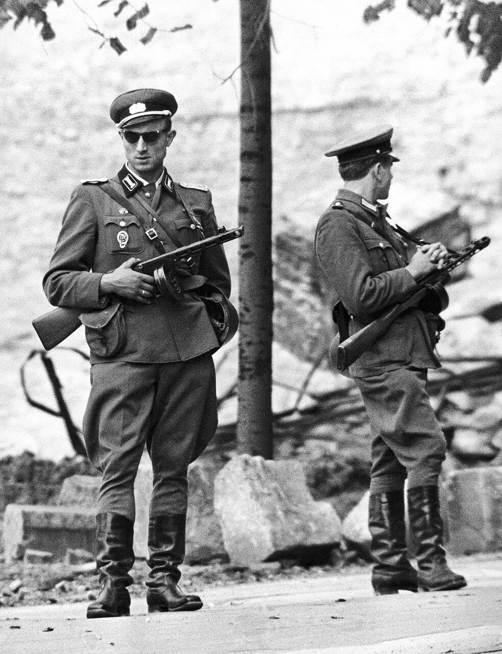 Soldiers from the East German National People's Army, man an unfinished part of the Berlin Wall on August 18, 1961.jpg