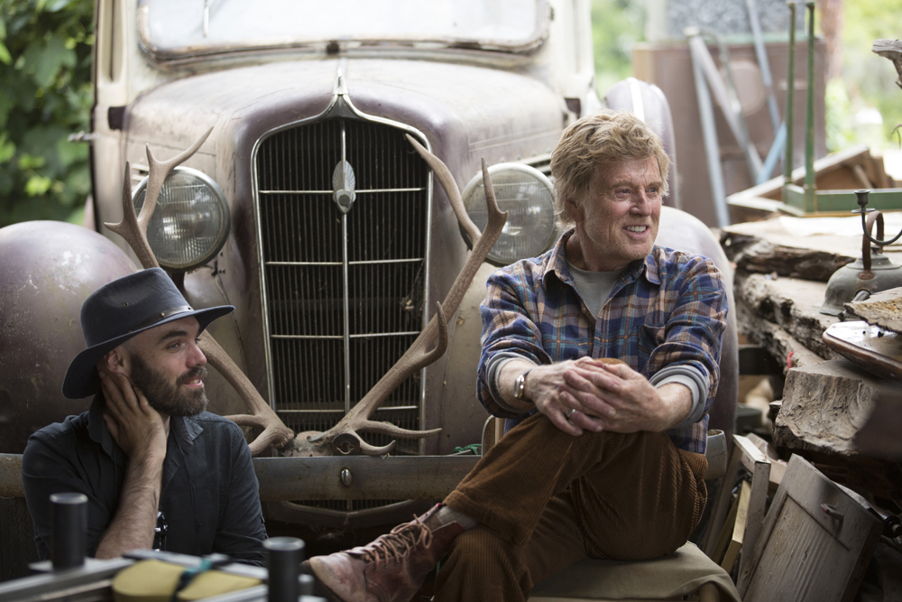 Director David Lowery and Robert Redford on the set of Disney's PETE'S DRAGON, the adventure of a boy named Pete and his best friend Elliot, who just happens to be a dragon.