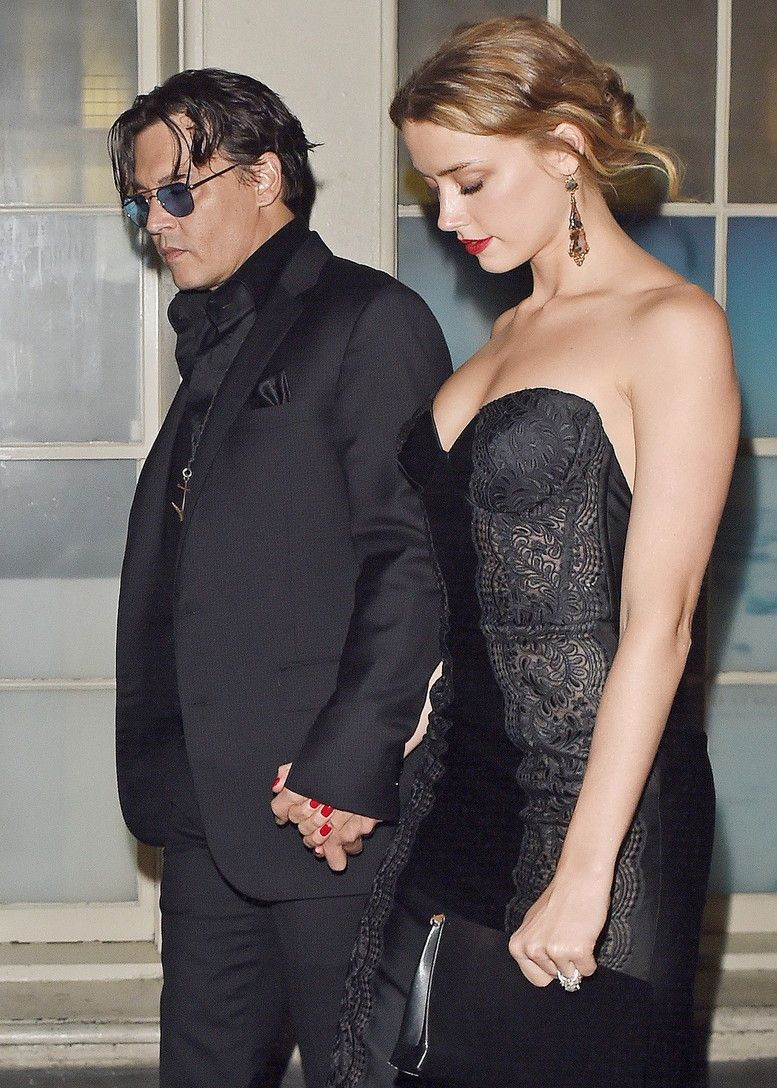 *EXCLUSIVE* Johnny Depp and Amber Heard exit a back door after the GQ award show **USA ONLY**