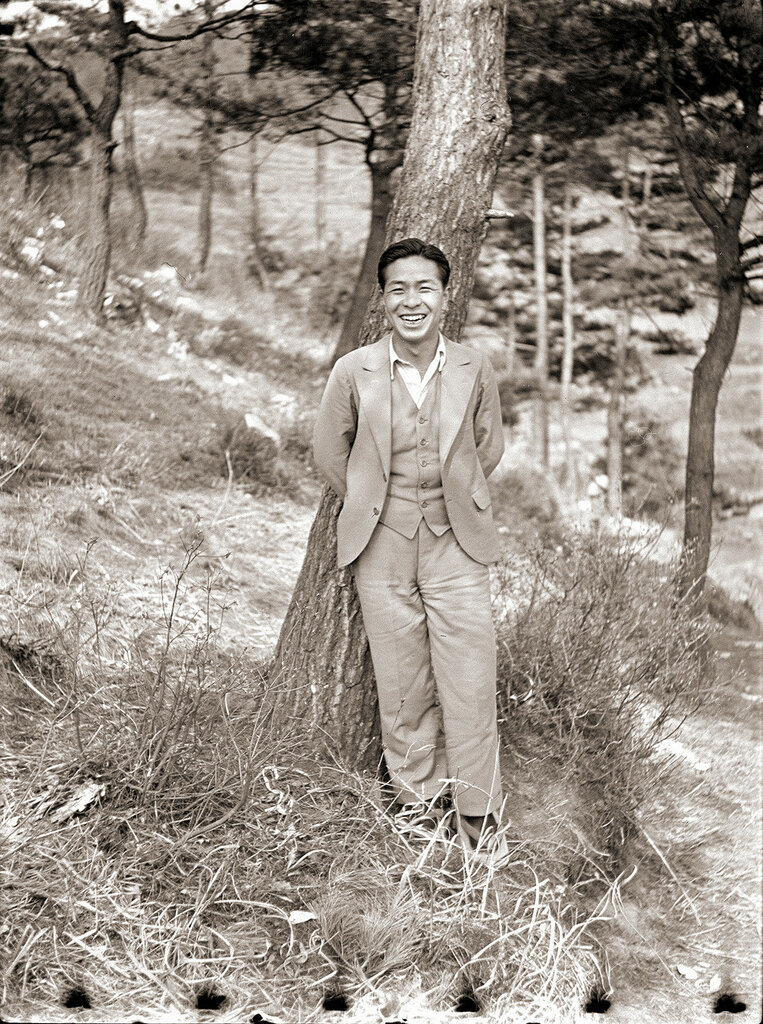 Smiling Man in Suit Near Tree, 1930s Japan.