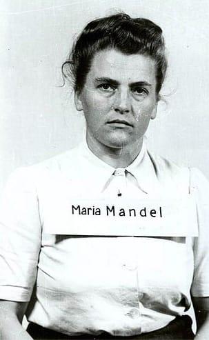 С 1942 по 1945 она занимала должность начальника женского отделения концлагеря Аушвиц-Биркенау.