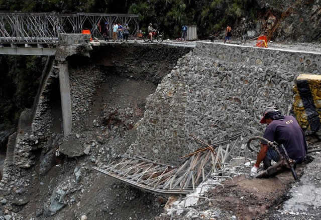 A partially damaged bridge at the height of Typhoon Haima is pictured in Benguet province, Philippin