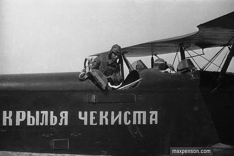 Aviators in cockpit of Security forces wings airplane, task air force of NKVD, based in Tashkent in 1930s..jpg
