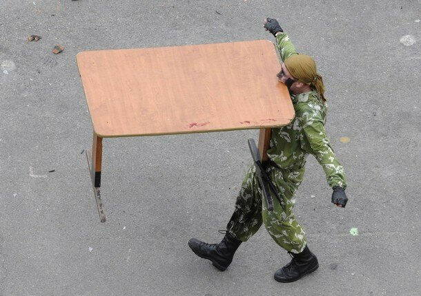 A Russian soldier carries a desk with his teeth during a ceremony celebrating Navy Day at the harbour of Russia's far eastern city of Vladivostok