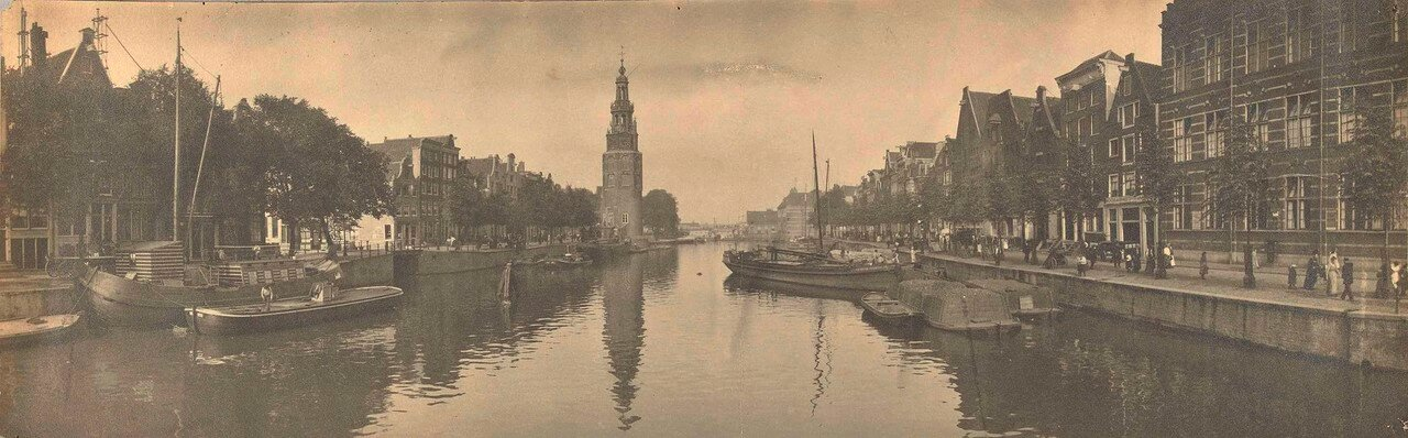 1900. Панорама Амстердама с башней Монтелбансторен и каналом Аудесханс