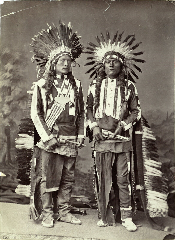 Utes in full gala dress. Jim Bush (left) and John Tyler (right), between 1870 and 1881