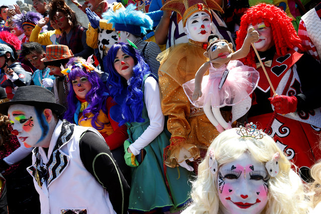Clowns get ready for the annual picture part of the XXI Convention of Clowns, at the Monument to the
