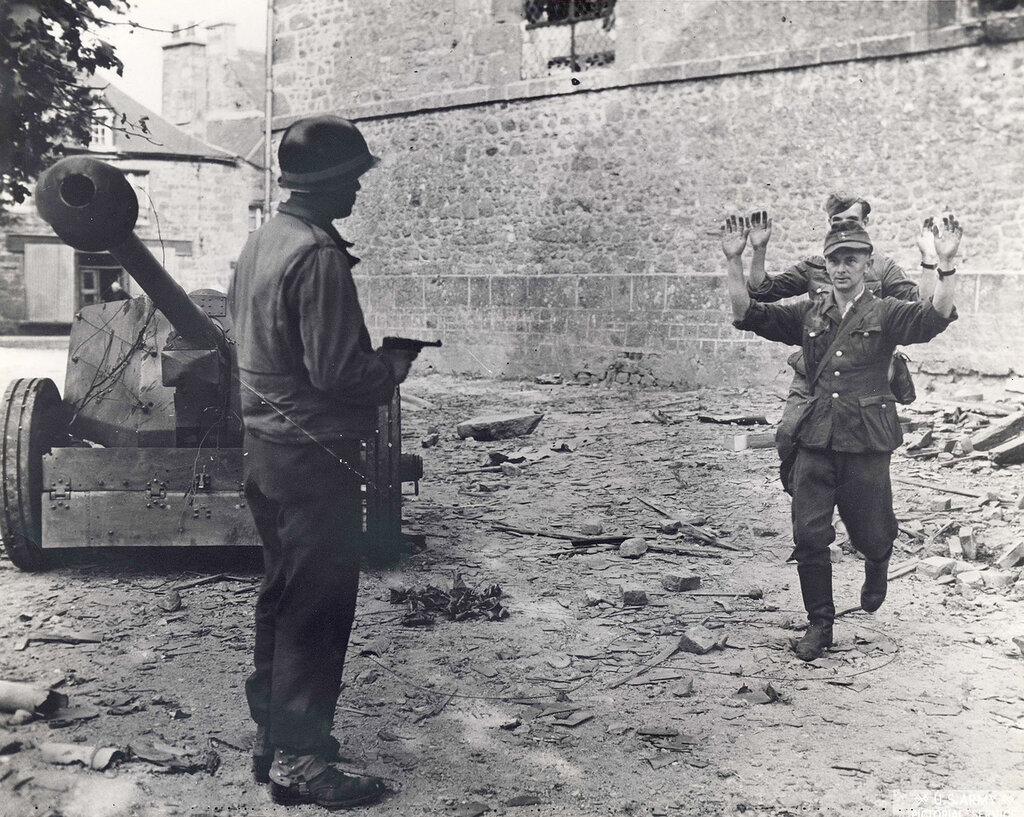 Collection Rodger Hamilton: The War Photoshttp://wosu.org/2012/archive/hamilton/gallery.php?page=gallery1Two soldiers surrendering; third soldier with gun next to tank. A few other photos have some staginess to them, but this surrender shot does not.