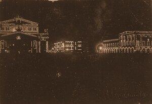 Вид празднично украшенных к торжествам коронации зданий на Театральной площади; слева - здание Большого театра (ночная иллюминация).