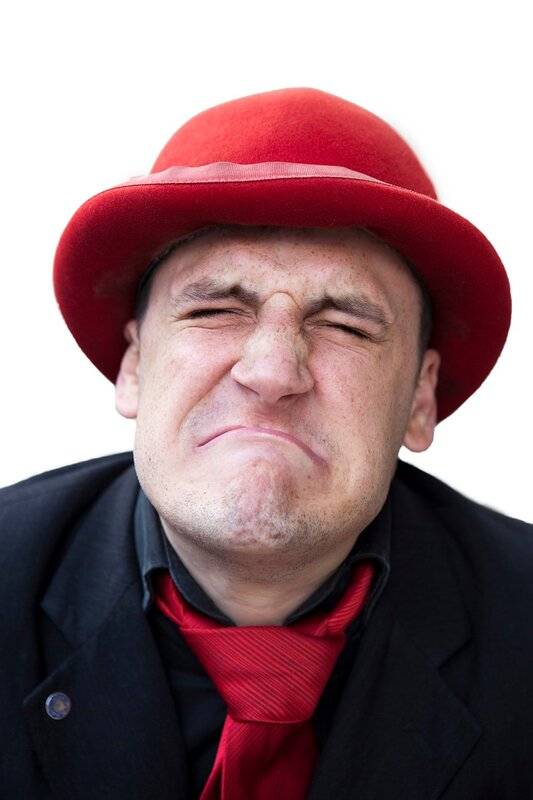 crying sad man in red hat