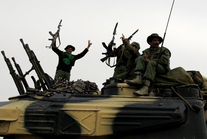 Libyan government soldiers celebrate at the west gate of  town Ajdabiya town