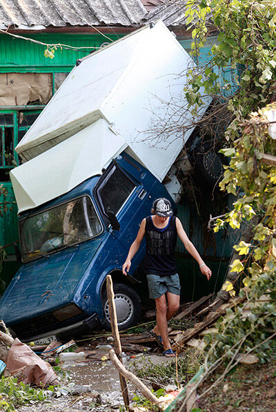 A vehicle damaged by floods in the town of Krymsk