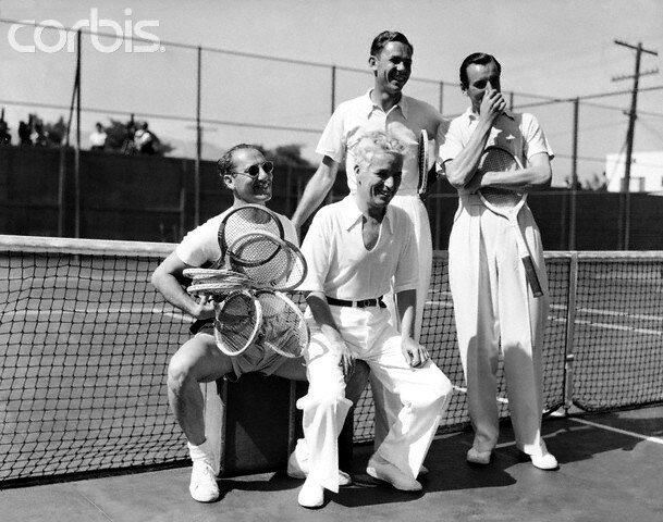 13 Jul 1937, Beverly Hills, California, USA --- 7/13/1937-Beverly Hills, CA- In the world's screwiest tennis match, Fred Perry and Charlie Chaplin defeated Ellsworth Vines and Groucho Marx recently, at the Beverly Hills Tennis Club.  Here are the players
