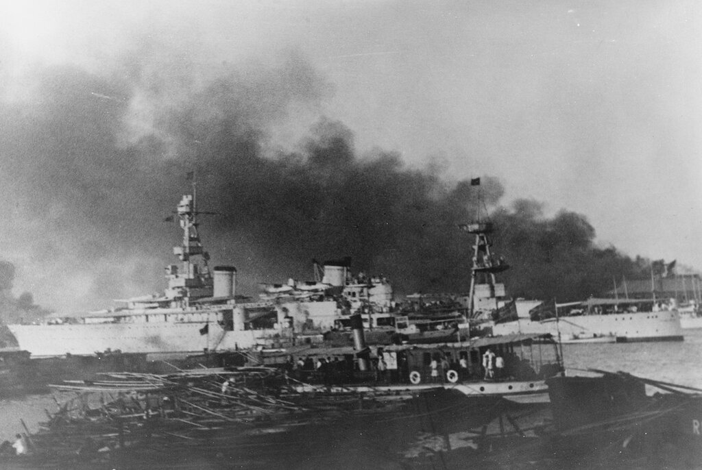 USS AUGUSTA (CA-31) Off Pootung Point, Shanghai, China, circa 1937. Smoke is from burning cotton mills on Pootung Point.