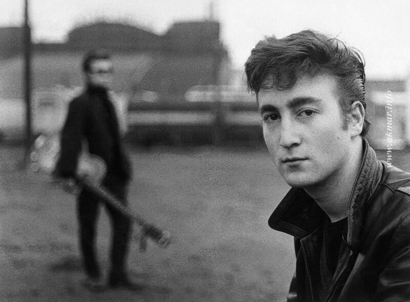 The Beatles - John Lennon with Stuart Sutcliffe in background.