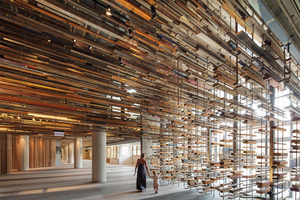 Stunning Entryway of the Nishi Building Includes a Suspended Ceiling of 2,150 Reclaimed Boards from Old Homes and a Basketball Court