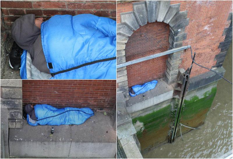 London homeless sleeps on a concrete ledge above the Thames