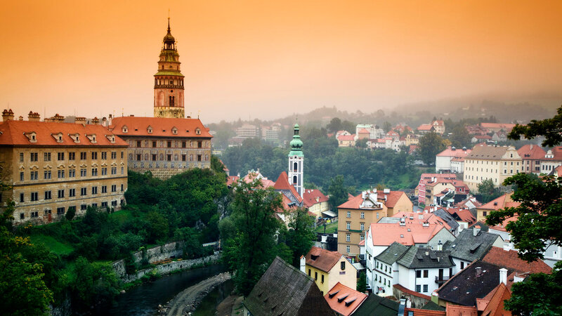 the Cesky Krumlov Castle seen across rooftops in the town of Cesky Krumlov in the Czech Republic