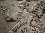 ancient-assyrian-wall-carvings-23136062.jpg