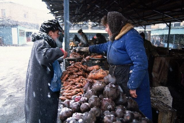 Woman Selling Produce at Moscow Market