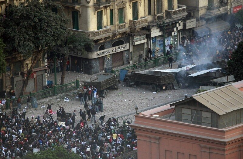 Pro-government protesters clash with anti-government protesters in Tahrir Square in Cairo