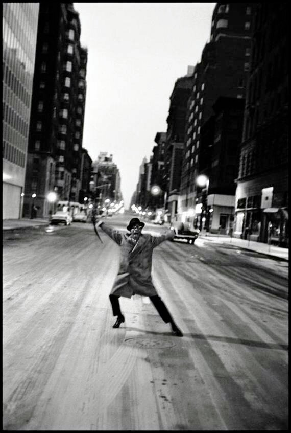 New York, New York. 1959. Sammy Davis Jr. dances across Madison Avenue after his last show at the Copa Cabana