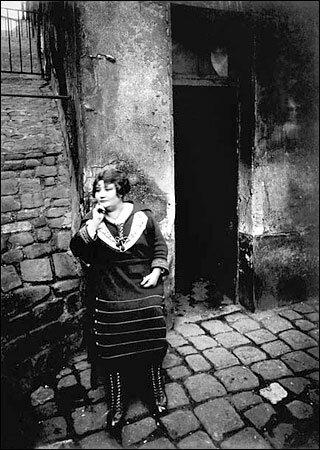 Eugène Atget, Prostitute in the Rue Asselin (1921)