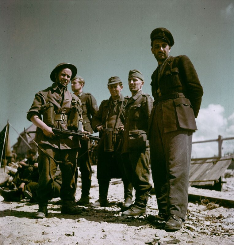 Canadian soldier with a group of German POWs