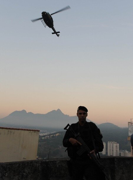 A police helicopter overflies Rio de Jan