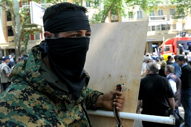 A Georgian opposition activist armed wit