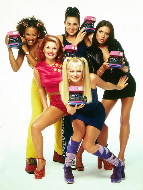 The Spice Girls with Polaroid  cameras