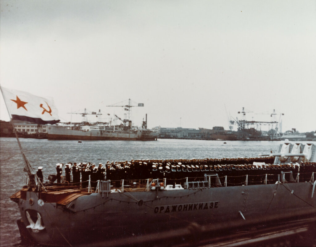 ORDZHONIKIDZE (Soviet Cruiser, 1950-1973) View of the stern of the cruiser, during August 1956 at Copenhagen, Denmark. The ship's band appears in the foreground