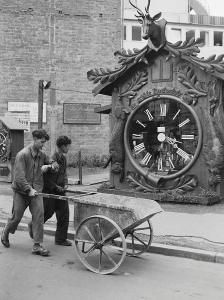 Man Checking Time by Large Clock