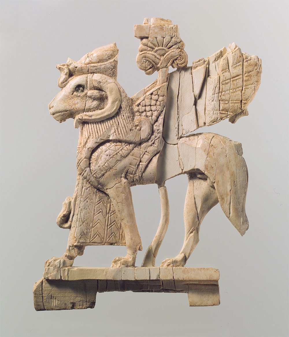 Openwork furniture plaque with ram-headed sphinx. Neo-Assyrian. ca. 9th–8th century B.C.
