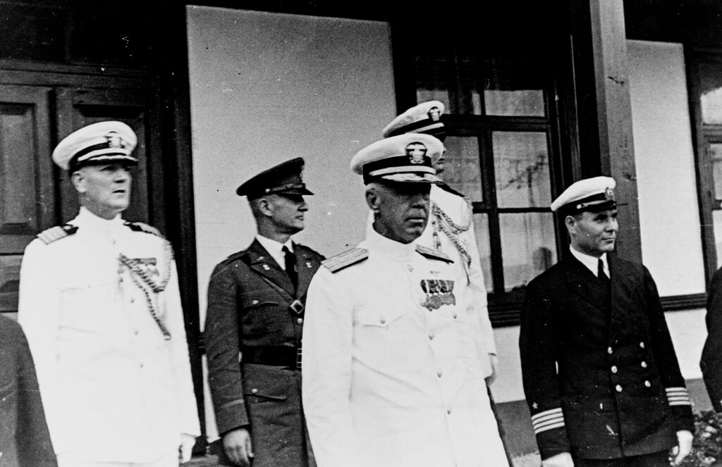 Admiral Harry E. Yarnell, USN. As commander-in-chief U.S. Asiatic Fleet, while at Vladivostok, USSR, July 1937. Others present: (L to R) Captain R. F. McConnell, USN (Chief of staff to CINCAF), Colonel P.R. Faymonville, USA (Military Attaché to USSR), Admiral H.E. Yarnell, USN (CINCAF), Lieutenant J. Sylvester, USN (Flag Lieutenant to CINCAF), unidentified Russian Navy Captain.