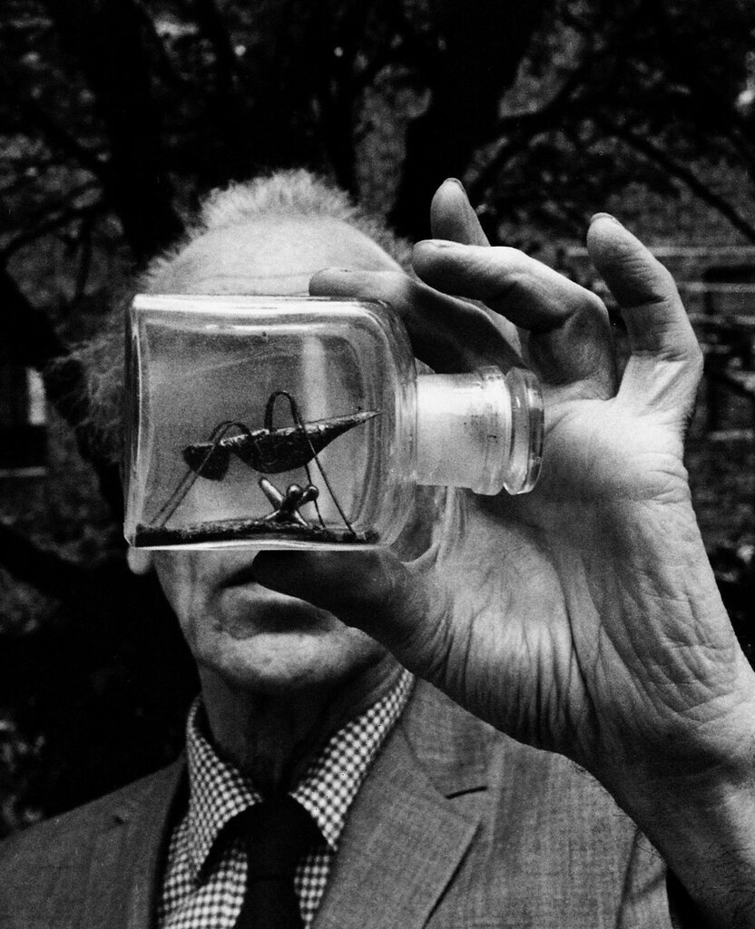 "Joseph Cornell holding an Untitled Bottle Object""  photo Duane Michals, 1969"