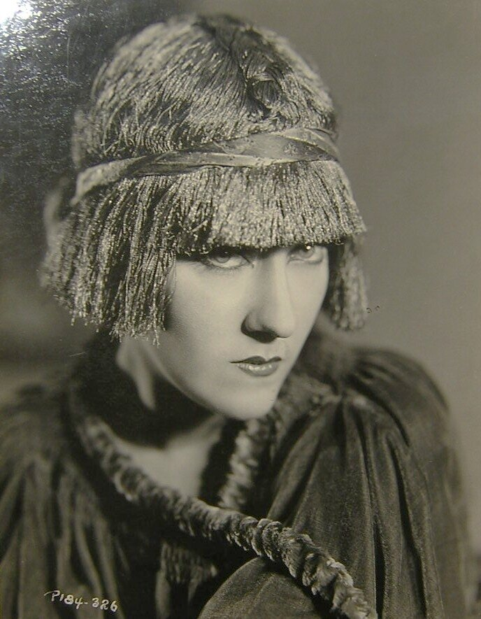 Gloria Swanson is wearing a french boudior cap