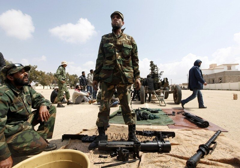 New volunteer rebel fighters receive training on how to use an anti-aircraft gun at a military camp in Benghazi