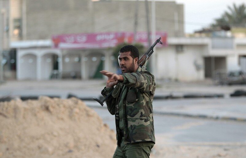 A Libyan soldier loyal to leader Muammar Gaddafi stands in the city of Misrata